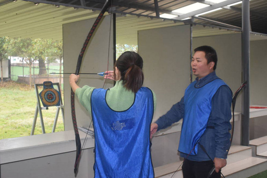 Teams practice archery together.jpg