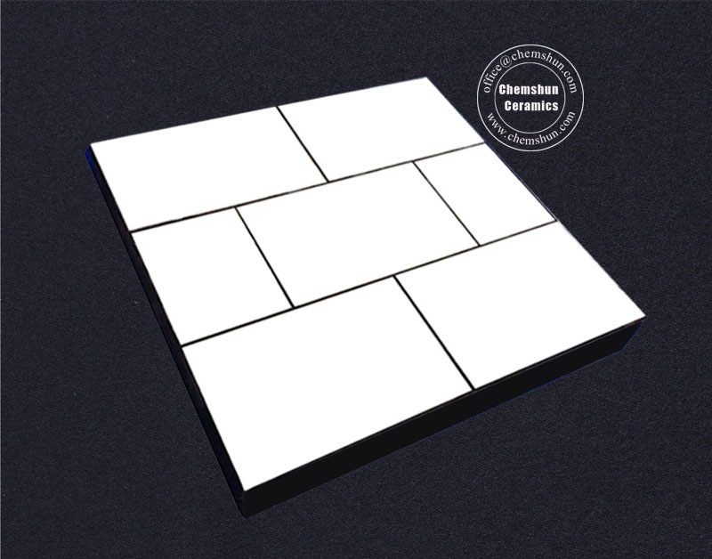 Rubber backed alumina ceramic tiles