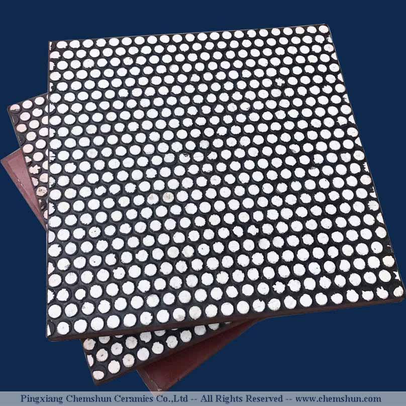 Rubber backed alumina ceramic tiles